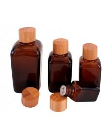 Flascó quadrat de vidre ambre amb tapa bambú rosca 18mm i tap degotador, 100 ml